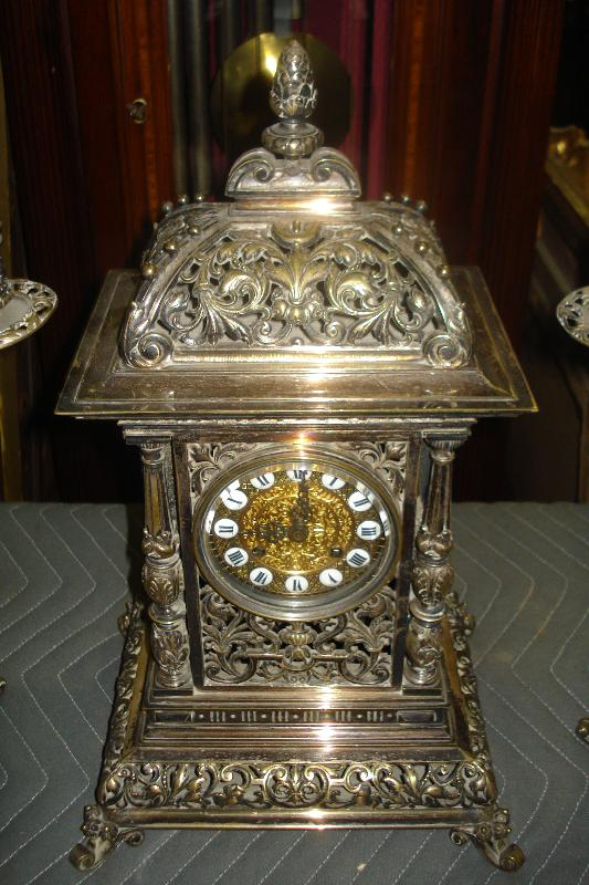 Nineteenth Century French Theree Piece Clock Set Silver Over Bronze, Pierced In The Moorish Orientalist Style, With Matching Candelabra