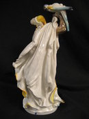Meissen Porcelain Figurine of An African Woman Dancing with A Parrot on Her Right Hand