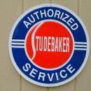OUR LARGEST AUTHORIZED STUDEBAKER SERVICE GARAGE METAL SIGN // MADE IN USA