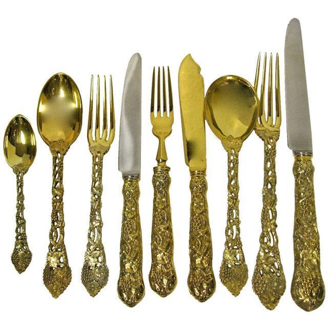 ASPREY, Sterling Silver Gilt, Chased & Pierced Grape & Vine Pattern Flatware Set. Complete