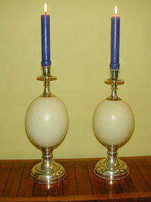 Pair of  Ostrich Eggs  and silverered metal Candlesticks