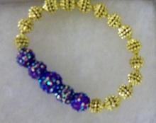 Shamballa beaded bracelet with gold tone beads