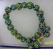 Shamballa beaded dark green aurora borealis earrings and bracelets