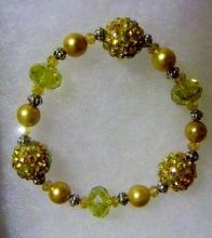 Shamballa gold tone earrings and bracelets