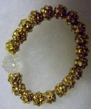 Shamballa gold and clear earrings and bracelets