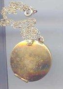 SALE Gold Tone Heart Locket.