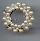 SALE Simulated Pearls in a Circle Pin.