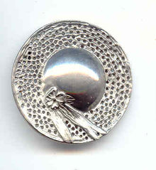 Beautiful Hat Pin looks like pewter.