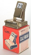old vintage 1950s BRASS PERPETUAL TOY DESK CALENDAR in box