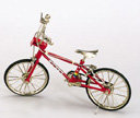 RED TOY BICYCLE / BIKE / MOTION TOYS DOLL