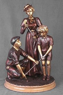 TEACHING GOLF STATUE / RESIN FIGURE