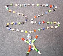 Glass Stick Figure Necklace Carnival Toy