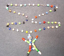 Glass Stick Figure Necklace Carnival Toy