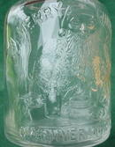 1936 Overland Mould Co. Adver. Santa Christmas Bottle