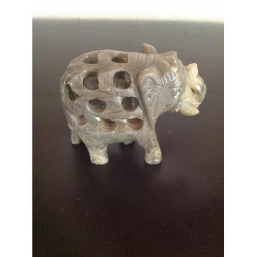 A Very Uniquely Carved Green Jade Large Elephant Figure