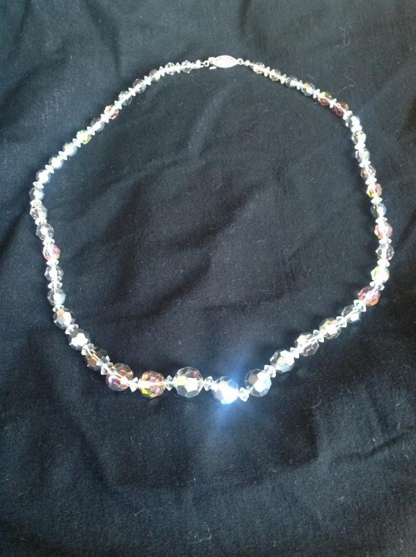 A classy string of silver-toned crystal beaded necklace
