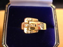 Sweet Diamond and 14Kt Yellow Gold Buckle Ring