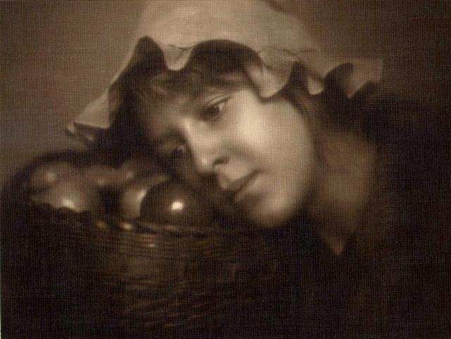 EG Studio (attrib.): Woman with Basket of Fruit