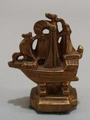 Cast mini Sail boat paperweight.