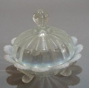 3 footed white opalescent candy bowl and lid.