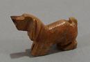 Dashound carved stone animal.