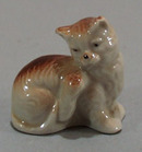 Old porcelain kitty mini figurine.