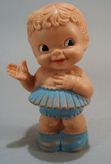 Soft squeaker rubber doll, blue skirt and shoes