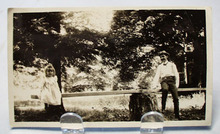 Old Photo of Man and little girl on teeter totter.