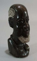 Carved stone bookend of Tribal man