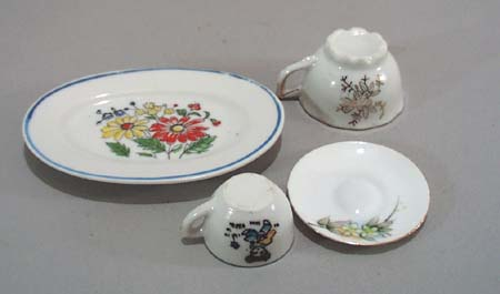 4 pc childs dishes, a platter, 2 cups and a saucer