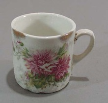 Old porcelain mug with great unusual pattern in porcelain.