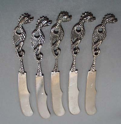 5 dragon handled butter spreaders.