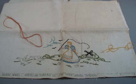 Dishtowel with dutch girl chasing geese.