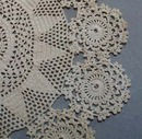Tiny stitched crochet doily.