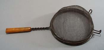 Yellow/brown bakelite handle strainer