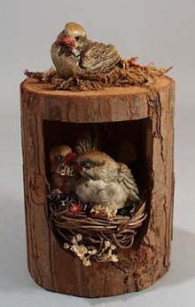 Enesco Lovebirds in tree sitting in Rattan Nest,