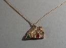 Childs necklace with home with heart