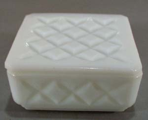 Glass Refrigerator or trinket box with cross design.