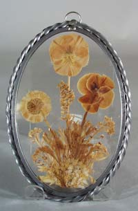 Leaded glass suncatcher with real pansy inside.