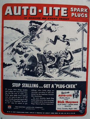 Auto Lite Plugs Car Stuck On Tracks Ad 1945