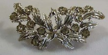 Crystal & Silvertone Leaf Brooch