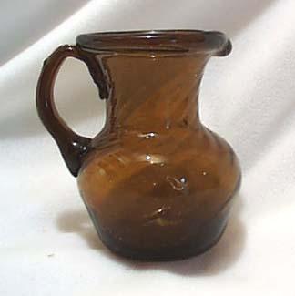 Hand blown dk amber creamer or mini pitcher.