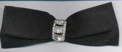 Black ribbon bow with rhinestone pin.  Pin is