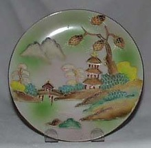 Moriage on porcelain plate Japan pagoda scene