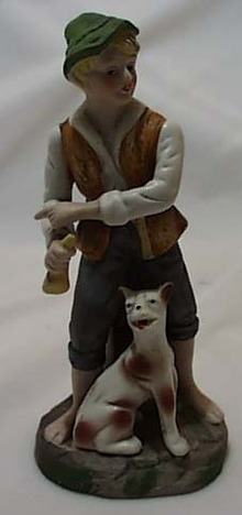 Bisque porcelain boy, dog & bone figurine