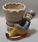 Unusual Holland Boy Holding Flowerpot