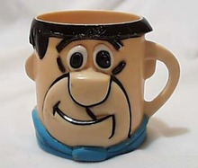 Fred Flintstone advertising mug, blue necktie