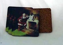 Coasters of Santa by a fire place with a Coke