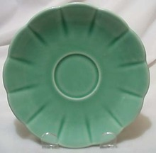 W S George petalware saucer in green