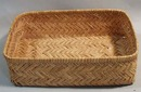 Oblong basket woven of Straw